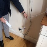 Wires everwhere; kettle not reaching plug so 4-gang left to bridge the gap. Dangerous?