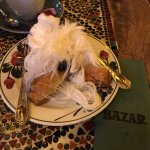 """Baklava topped with """"cotton candy"""" and dates."""