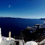 Taking atop  Fira  at different times of day