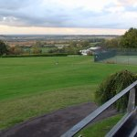 View from Pavillion room balcony over golf course and tennis courts towards Cotswolds