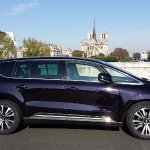 Our brand new deluxe minivan by Notre Dame cathedral-Paris