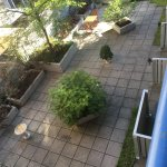 View from balcony of room overlooking outside courtyard
