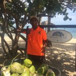 Dennis the #CoconutBoss. Incredible smile and gracious manner.  He will make your day wonderful