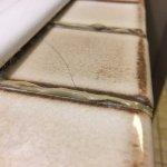 Broken tiles in bathroom