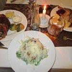 """Koleno"", roasted duck, and caesar salad."