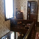 View from top of staircase looking at Irish Rose door