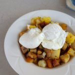 Poached Eggs on bed of mixed ground provisions