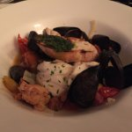 Fisherman's Stew - lobster, cod, mussels, sausage, tomatoes, onions, and broth.