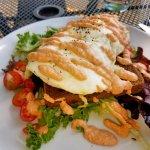Breakfast Panzanella....greens, rye toast, goat cheese, Michigan sausage, eggs, tomato garlic ai