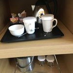 Water percolator, cups, glasses and coffee