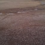 Gravel parking lot. Lots of room for vehicles and trailers.