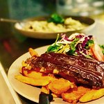 Rib Fest Thursdays, BBQ Bourbon Pork Ribs served with Sweet Potato Wedges, Garden Salad and Scho
