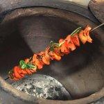 Cooking Paneer tikka in the tandoor