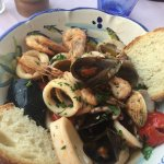 The mixed seafood appetizer with tomato sauce. Mmmm!