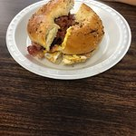 Double bacon, double eggs on an everything bagel