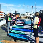 Spousal program - ladies getting ready to do some yoga paddle boarding!