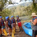 One of the guides giving detailed instructions on how to hold the paddle