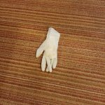 Used glove in the room floor