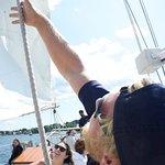 Crew pulling the mast up.
