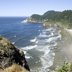 Heceta Head Lighthouse is surrounded by wide sandy beaches and brilliant blue waters along the c