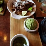 Ancho braised beef brisket taquitos with guac and salsa verde