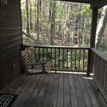 The porch swing with a gorgeous view of the woods!