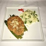 Grouper crusted with shaved bacalhau, with asparagus.