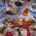 Monkfish and prawn kebab; suckling pig with side salad
