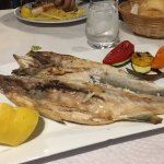 Grilled whole sea bass with side of grilled vegetables