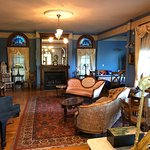 Living room area with lots of antiques and beautiful decor