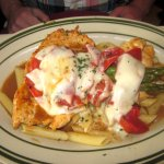 Chicken Pulcinella topped with red peppers, asparagus, & mozzarella