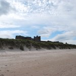 Bamburgh Castle as seen over the dunes