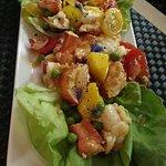 Lobster Salad with mango, cherry tomato, peas, chili oil, bibb lettuce, & fresh lemon juice.