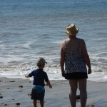 Mother and grandson Thomas ponder Cape Cod Bay