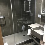 Clean and modern but bathroom flooded when I showered