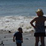 Thomas and Grandma contemplating the surf