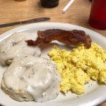 Scrambled eggs with bacon, biscuit and gravy