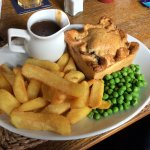 Home made Steak and Ale pie, chips peas and gravy. Yummy - Well recommended!