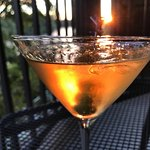 Sunset Martini on our balcony overlooking the river