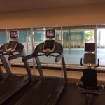 Gym treadmills overlook the indoor pool.