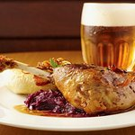 Leg of young goose, served with apple-flavoured red sauerkraut and potato dumplings
