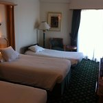 A Typical Triple Room - the door opens to a balcony overlooking the river