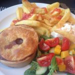 Steak pie with chips and a fresh salad
