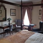 large room with four poster bed