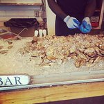 Shucking oysters at the Shack raw bar