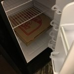 Left over pizza in box doesn't fit in ref, waste of leftover pizza and NO microwave in hotel roo
