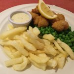 Wholetail scamp with chips, peas and chips