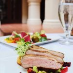 Roasted Maple Leaf Farms Duck Breast with butterbean purée and a toasted corn cake
