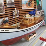 Model boat and historical pictures