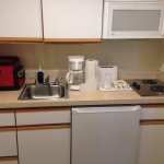 clean & well stocked kitchen area with pots, dishes, utensils. Nice size fridge & freezer